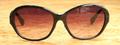 【女性らしい美しい曲線を描くミドルサイズサングラス】OLIVER PEOPLES Anwen BK