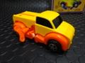 ゼンマイ仕掛けのゆかいなオモチャ!!「トランスフォーマー  変身トラック/ドッグルフォード オレンジ」  驚愕の自走・変身!今人気です。売り切れたらゴメンね~