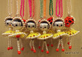 ビーズガールネックレス / 赤帽子×黄色スカート