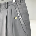 grey pants with embroidered letters