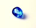0.11ct UVライトで強蛍光! テリのよい濃いコバルトブルーの希少石 アフガナイト