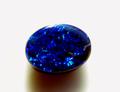 0.99ct希少石 コバルトブルー~シアングリーンのプレイ・オブ・カラー オーストラリア産ブラックオパール