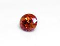 1.01ct 高い透明感と落ち着いたオレンジカラーをした変色石 タンザニア産オレンジマラヤガーネット
