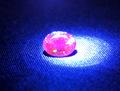 0.64ct UVライトで蛍光!! 煌びやかな黄金色の宝石 メレラニUVゴールデンインペリアルガーネット