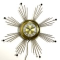 ~60s UNITED SUNBURST WALL CLOCK.