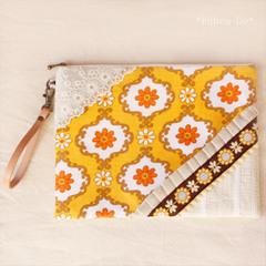 【SALE】vin生地とチロルのクラッチバッグ 黄色いお花チロル