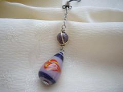 カジュアルでファンシー ワイヤラップビーズと紫のハンドペイントビーズの帯飾り