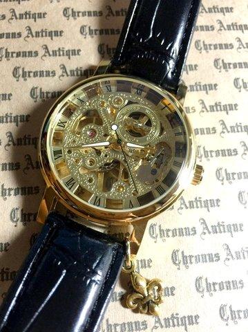802.手巻きスケルトン腕時計(金顔黒ベルト)