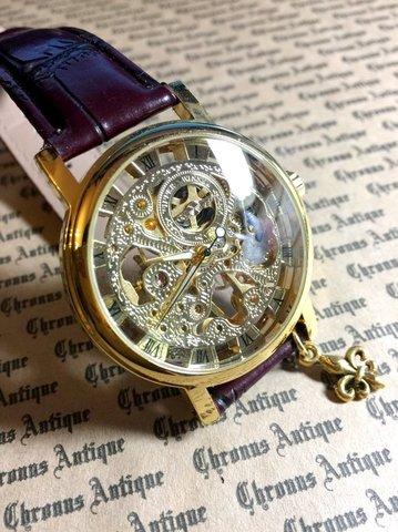 801.手巻きスケルトン腕時計(金顔茶ベルト)