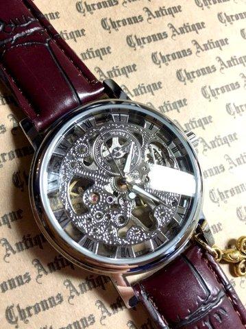 807.手巻きスケルトン腕時計(銀顔茶ベルト)