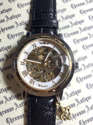 815.手巻きスケルトン腕時計(ホイール白顔金文字)