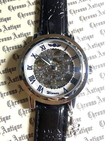 812.手巻きスケルトン腕時計(ホイール白顔青文字)