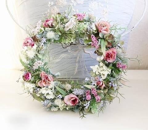 パステルカラーのお花たちのリース