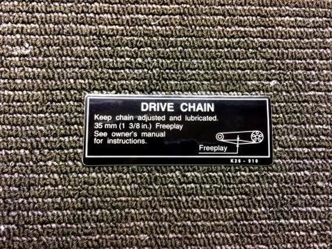 GROM US CAUTION LABEL SWING ARM Drive Chain Info