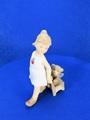 ポーセリン人形 子犬を載せたカートを曳く少女