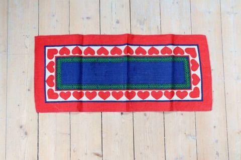 ハートのクリスマスモチーフのプリントクロス/麻材(63.5×27.5cm)
